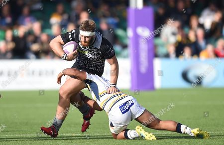 Rhodri Jones of Ospreys is tackled by Ollie Lawrence of Worcester Warriors.