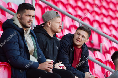 Scarlets players Tom Price, Dylan Evans and Steff Evans watch the game