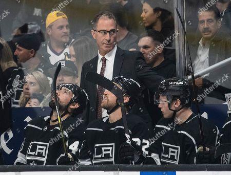 Stock Image of Los Angeles Kings head coach John Stevens, top, during an NHL hockey game against the New York Islanders in Los Angeles