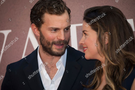 Amelia Warner, Jamie Dornan. Amelia Warner and Jamie Dornan pose for photographers upon arrival at the premiere of the film 'A Private War' showing as part of the BFI London Film Festival in London