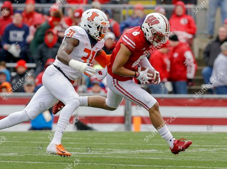 Wisconsin wide receiver Danny Davis (6) makes a reception against Illinois defensive back Cameron Watkins during the first half of an NCAA college football game, in Madison, Wis