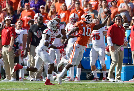 Derion Kendrick, Chris Ingram. Clemson's Derion Kendrick (10) tries a one-handed catch while defended by North Carolina State'sChris Ingram during the first half of an NCAA college football game, in Clemson, S.C. Clemson won 41-7
