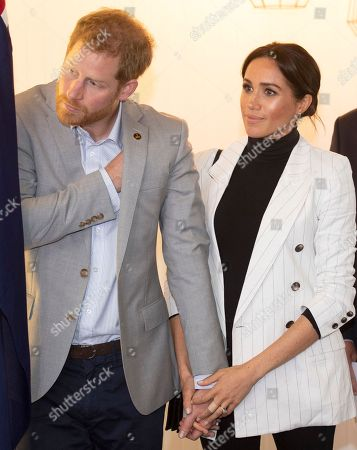 Britain's Prince Harry and his wife Meghan Duchess of Sussex, attend a lunchtime reception hosted by Australian Prime Minister Scott Morrison with Invictus Games competitors, their families and friends in Sydney