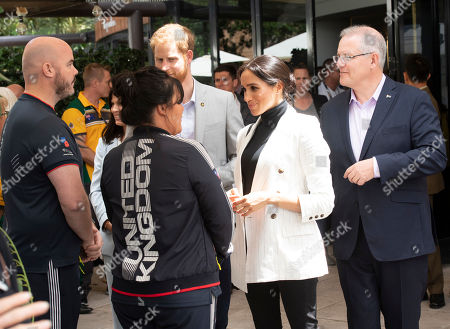 Meghan Duchess of Sussex, and her husband Britain's Prince Harry, center, attend a lunchtime reception hosted by Australian Prime Minister Scott Morrison with Invictus Games competitors, their families and friends in Sydney