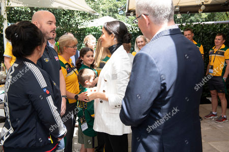 Meghan Duchess of Sussex, center, speaks as she attends a lunchtime reception hosted by Australian Prime Minister Scott Morrison with Invictus Games competitors, their families and friends in Sydney