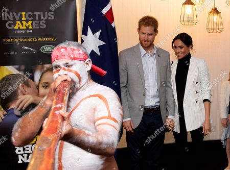 Harry, Meghan. Britain's Prince Harry, center, and his wife Meghan, right, the Duchess Sussex attend a lunchtime reception hosted by Prime Minister Scott Morrison with Invictus Games competitors, their family and friends in the city's central parkland in Sydney on