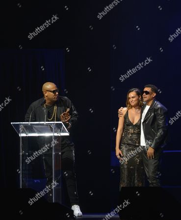 Alexander Delgado and Randy Malcom of Gente de Zona on stage at the 6th Annual Latin Songwriters Hall Of Fame La Musa Awards at James L Knight Center