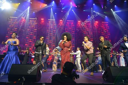 Randy Malcom and Alexander Delgado of Gente de Zona, Aymee Nuviola and Ektor Rivera performs during the Grand Finale at the 6th Annual Latin Songwriters Hall Of Fame La Musa Awards at James L Knight Center