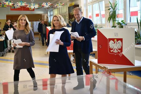 European Council President Donald Tusk (R) with his wife Malgorzata Tusk (C) and daughter Katarzyna Tusk (L) cast their votes at a polling station in Sopot, Poland, 21 October 2018. Poles are to elect nearly 47,000 district, county and provincial councillors and close to 2,500 district heads and town and city mayors. There are over 30 million Poles eligible to vote.