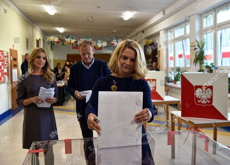 Stock Photo of European Council President Donald Tusk (C) with his wife Malgorzata Tusk (R) and daughter Katarzyna Tusk (L) cast their votes at a polling station in Sopot, Poland, 21 October 2018. Poles are to elect nearly 47,000 district, county and provincial councillors and close to 2,500 district heads and town and city mayors. There are over 30 million Poles eligible to vote.
