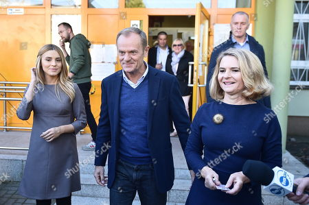 Stock Picture of European Council President Donald Tusk (C) with his wife Malgorzata Tusk (R) and daughter Katarzyna Tusk (L) leave after casting their votes at a polling station in Sopot, Poland, 21 October 2018. Poles are to elect nearly 47,000 district, county and provincial councillors and close to 2,500 district heads and town and city mayors. There are over 30 million Poles eligible to vote.