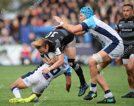 Joel Hodgson of Newcastle Falcons is brought down by Aaron Cruden of Montpellier