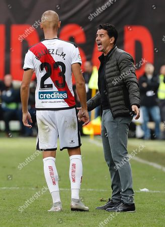 Rayo Vallecano's head coach, Miguel Angel Sanchez aka Michel (R), gives instructions to Rayo Vallecano's Alejandro Galvez during the Spanish La Liga soccer match between Rayo Vallecano and Getafe at the stadium of Vallecas, in Madrid, Spain, 21 October 2018.