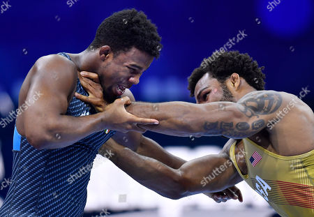 Stock Image of Frank Chamizo Marquez (blue) of Italy and US Jordan Ernest Burroughs fight during their bronze medal bout in the men's freestyle 74 kg category of Wrestling World Championships, in Budapest, Hungary, 21 October 2018.