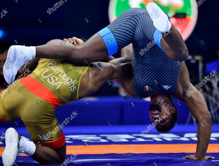 Stock Picture of Frank Chamizo Marquez (blue) of Italy and US Jordan Ernest Burroughs fight during their bronze medal bout in the men's freestyle 74 kg category of Wrestling World Championships, in Budapest, Hungary, 21 October 2018.