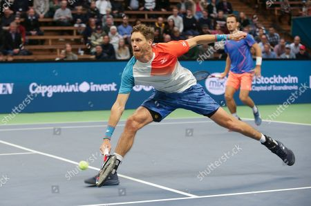 Marcus Daniell (L) of New Zealand and Wesley Koolhof of The Netherlands in action during the ATP Stockholm Open tennis tournament doubles final match against Britain's Luke Bambridge and Jonny O'Mara at the ATP tennis tournament Stockholm Open in Stockholm, Sweden, 21 October 2018.