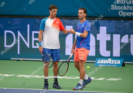 Marcus Daniell (L) of New Zealand and Wesley Koolhof of The Netherlands react during the ATP Stockholm Open tennis tournament doubles final match against Britain's Luke Bambridge and Jonny O'Mara at the ATP tennis tournament Stockholm Open in Stockholm, Sweden, 21 October 2018.