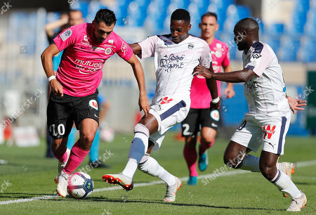 Gaetan Laborde (L) of Montpellier HSC , Youssouf Sabaly (R) and Younousse Sankhare (C) of Girondins Bordeaux in action during the Soccer ligue 1 match between Montpellier HSC and Girondins Bordeaux in Montpellier, France, 21 October 2018.