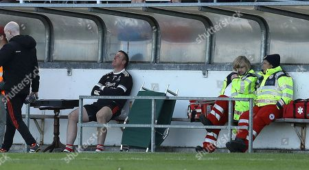 Stock Photo of Athy vs Moorefield. Athy's Stephen Davies sits in the dugout after being sent off