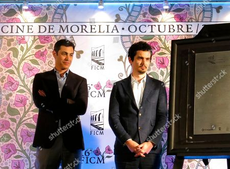 Director Damien Chazelle, right, and the writer Josh Singer, both from the U.S., unveil a plaque at the inauguration of the 16th edition of Morelia Film Festival in Morelia, Mexico