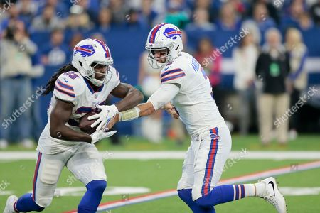 Buffalo Bills quarterback Derek Anderson (3) hands off to running back Chris Ivory (33) during the first half of an NFL football game against the Indianapolis Colts in Indianapolis