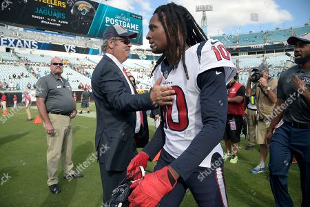 Houston Texans wide receiver DeAndre Hopkins (10) receives a congratulatory pat from team chairman Cal McNair on the field after an NFL football game against the Jacksonville Jaguars, in Jacksonville, Fla. The Texans won 20-7