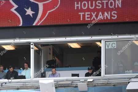 Jacksonville Jaguars executive vice president of football operations Tom Coughlin, center right, and general manager David Caldwell watch from a suite overlooking the field during the second half of an NFL football game against the Houston Texans, in Jacksonville, Fla. The Texans won 20-7