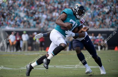 Stock Picture of Jacksonville Jaguars running back Jamaal Charles (31) is tackled by Houston Texans linebacker Zach Cunningham (41) after catching a pass during the second half of an NFL football game, in Jacksonville, Fla. The Texans won 20-7