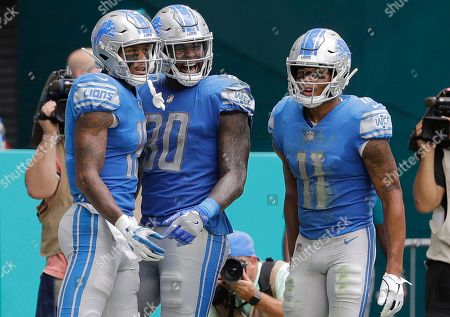Stock Picture of Michael Robert, Marvin Jones, Kenny Golladay. Detroit Lions tight end Michael Roberts (80) celebrates his touchdown with wide receivers Marvin Jones (11) and Kenny Golladay (19), during the second half of an NFL football game against the Miami Dolphins, in Miami Gardens, Fla