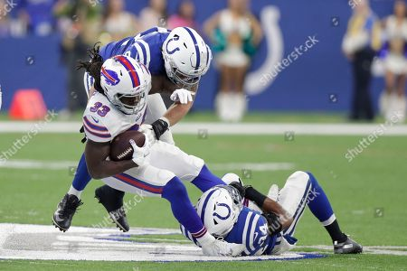 Mike Mitchell, Margus Hunt, Chris Ivory. Buffalo Bills running back Chris Ivory (33) is tackled by Indianapolis Colts defensive end Margus Hunt, top, and defensive back Mike Mitchell (34) during the first half of an NFL football game in Indianapolis
