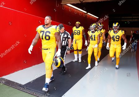 Los Angeles Rams guard Rodger Saffold (76) and teammates walk onto the field before the second half of an NFL football gameagainst the San Francisco 49ers in Santa Clara, Calif