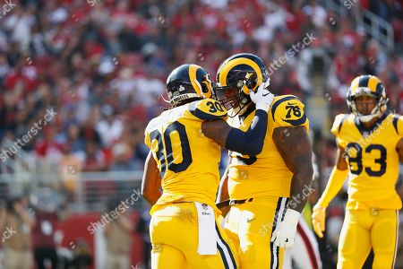 Los Angeles Rams running back Todd Gurley II (30) celebrates with guard Rodger Saffold (76) after scoring a touchdown against the San Francisco 49ers during the first half of an NFL football game in Santa Clara, Calif