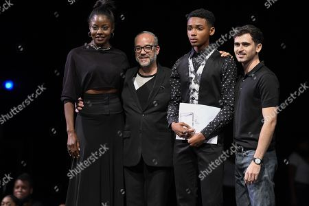 Men Top Model 2018 winner, Arion Perouse With Wendy Fitzwilliam left and John Bilboa, president of the jury