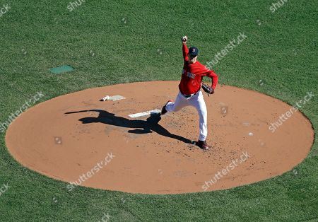 Boston Red Sox's Steven Wright pitches from the mound during a baseball workout at Fenway Park, in Boston. The Red Sox are preparing for Game 1 of the baseball World Series against the Los Angeles Dodgers scheduled for Tuesday in Boston