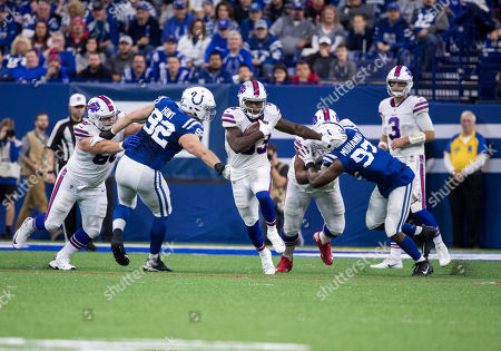 Buffalo Bills running back Chris Ivory (33) runs with the ball as Colts defenders pursue during NFL football game action between the Buffalo Bills and the Indianapolis Colts at Lucas Oil Stadium in Indianapolis, Indiana. Indianapolis defeated Buffalo 37-5