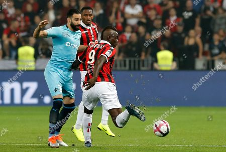 Mario Balotelli of OGC Nice (R) vies for the ball with Adil Rami of Olympique Marseille (L) during the French Ligue 1 soccer match between OGC Nice and Olympique Marseille, at the Allianz Riviera stadium, in Nice, France, 21 October 2018.