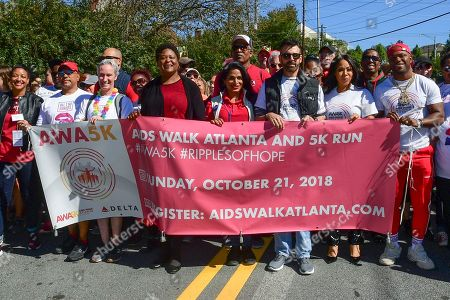 Grammy Award winning artist, Erica Campbell and VH-1's Love & Hip-Hop Hollywood star Milan Christopher (far right) join Atlanta City Council President Felicia Moore (center) and thousands of attendees in Piedmont Park to kick-off the 28th Annual Atlanta AIDS Walk & 5K Run, in Atlanta