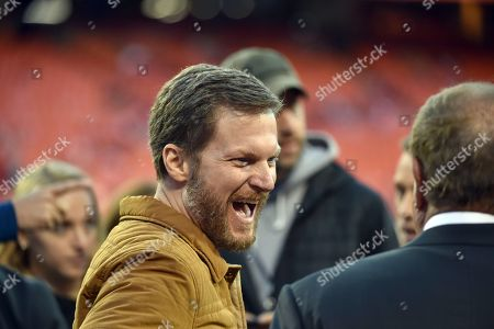 Dale Earnhardt Jr. jokes with staff members before an NFL football game between the Kansas City Chiefs and the Cincinnati Bengals in Kansas City, Mo