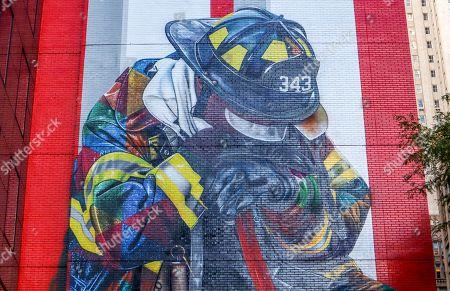 Brazilian artist Eduardo Kobra honors firefighters who worked on the September 11 attacks seen on Manhattan Island