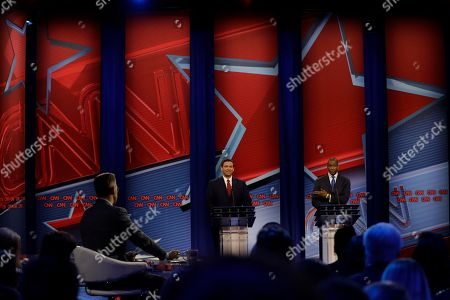 Moderator Jake Tapper, left, along with Republican gubernatorial candidate Ron DeSantis, center, and Florida Democratic gubernatorial candidate Andrew Gillum, right, during a CNN debate, in Tampa, Fla