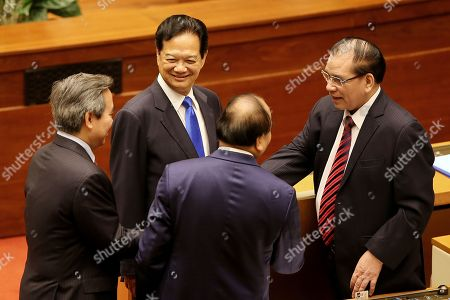 Vietnam's former Prime Minister Nguyen Tan Dung (2-L), Vietnam's Prime Minster Nguyen Xuan Phuc (C), Vietnam's former General Secretary Nong Duc Manh (R) talk at the opening of the sixth session of the 14th National Assembly in Hanoi, Vietnam, 22 October 2018.