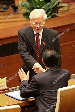 Stock Image of Vietnam's General Secretary Nguyen Phu Trong (back) shakes hands with Vietnam's former Prime Minister Nguyen Tan Dung (front) at the opening of the sixth session of the 14th National Assembly in Hanoi, Vietnam, 22 October 2018.