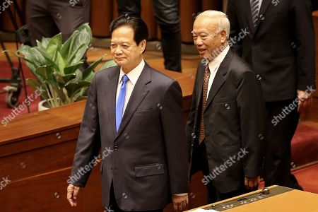 Stock Photo of Vietnam's former Prime Minister Nguyen Tan Dung (L), Vietnam's former Chairman of the National Assembly Nguyen Van An (R) arrive for opening of the sixth session of the 14th National Assembly in Hanoi, Vietnam, 22 October 2018.