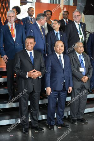 President of Ethiopia HE Mulatu Teshome (L), Prime Minister of the Socialist Republic of Vietnam HE Nguyen Xuan PhÅ?c (C), Minister of Foreign Affairs, Bangladesh HE Abul Hassan Mahmood Ali (R) pose for a family picture during the P4G Copenhagen Summit 2018 at The Danish Radio Concert Hall.