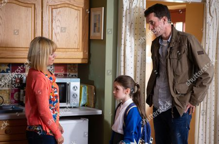 Ep 8292 Monday 22nd October 2018 April Windsor, as played by Amelia Flanagan, tells Rhona Goskirk, as played by Zoe Henry, and Marlon Dingle, as played by Mark Charnock, the reason Leo is being left out at school is because he keeps hitting the other kids and gets special treatment.