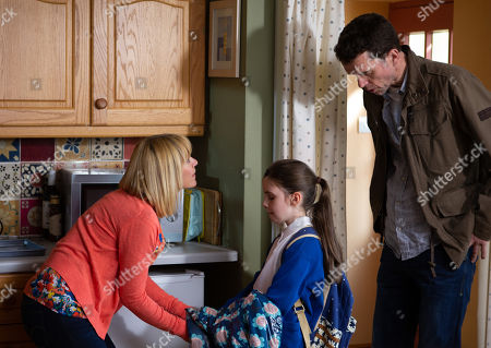 Stock Image of Ep 8292 Monday 22nd October 2018 April Windsor, as played by Amelia Flanagan, tells Rhona Goskirk, as played by Zoe Henry, and Marlon Dingle, as played by Mark Charnock, the reason Leo is being left out at school is because he keeps hitting the other kids and gets special treatment.