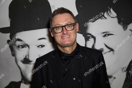 Jeff Pope poses for photographers upon arrival at the party for the film 'Stan and Ollie' showing as part of the BFI London Film Festival in London