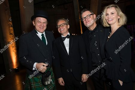 John C. Reilly, Jon S. Baird, Jeff Pope, Faye Ward. John C. Reilly, Jon S. Baird, Jeff Pope and Faye Ward pose for photographers upon arrival at the party for the film 'Stan and Ollie' showing as part of the BFI London Film Festival in London