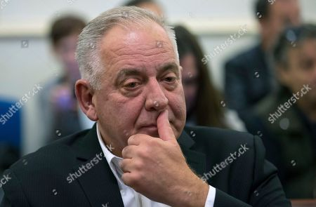Croatia's former prime minister Ivo Sanader sits in the courtroom prior to the reading of his verdict, in Zagreb, Croatia, . Sanader was sentenced Monday for two and a half years in prison for war profiteering
