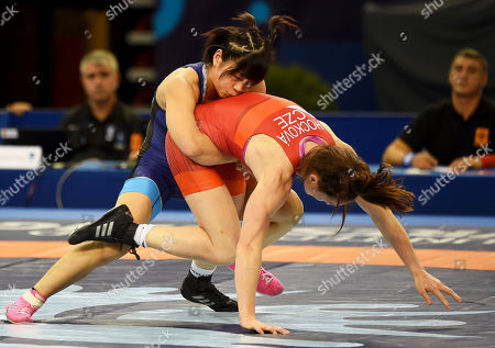 Mayu Mukaida (blue) of Japan in action against Lenka Hockova Martinakova (red) of the Czech Republic during the qualification round of the women's Freestyle 55kg category of the Wrestling World Championships in Budapest, Hungary, 22 October 2018.